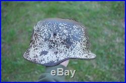 100% original german ww2 helmet winter camo, battle damaged shell. Stalingrad