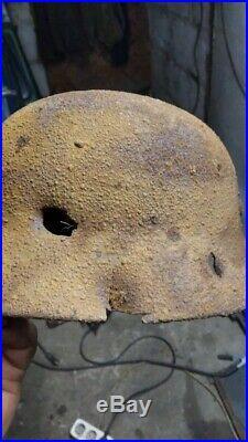 German WW2 Helmet Dug with a bullet hole