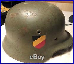ORIGINAL WW2 2 STICKER GERMAN HELMET. Size 57 Markings 4941, ET64
