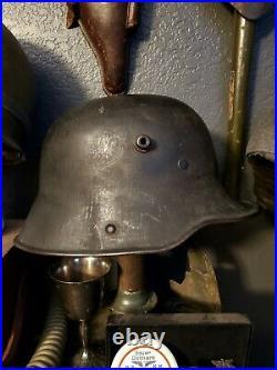 Original WW1 German to WW2 Transitional helmet. Named Finnish corporal