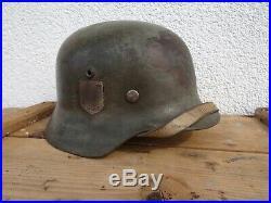 Original WWII German SS M35 Helmet with original helmet liner and strap RRR