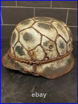 Replica WW2 German M40 helmet size 66 combat worn with wire reproduction. Made o