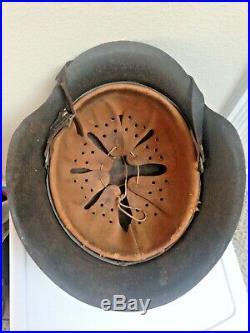 WW2 German Helmet Van Hoof with leather liner, chin strap, partial decal on side
