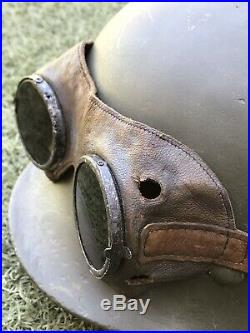 WW2 German helmet M35 and motorcycle goggles. The helmet is restored. Size 67