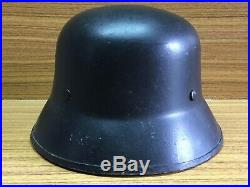 WW2 German volcano fiber parade helmet complete with liner and chin strap. M34