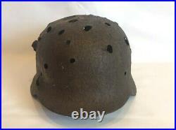 WW2 original German helmet M 40 with a lot of combat damage. Unique lot