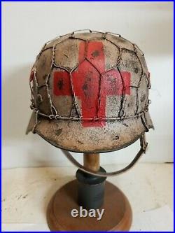 World War II German M35 Half Basket Winter Medic Camo Painted Aged Helmet